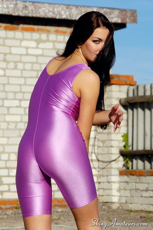 lustful athlete girl in purple skin tight lycra