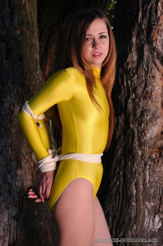 petite lady Dina in yellow leotards & rope bondage