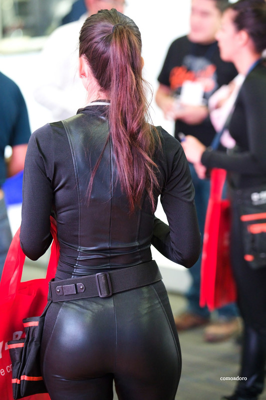 lovely promo girl in black shiny bodysuit