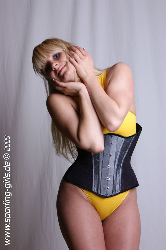 german babe Jana in sexy corset & yellow swimsuit