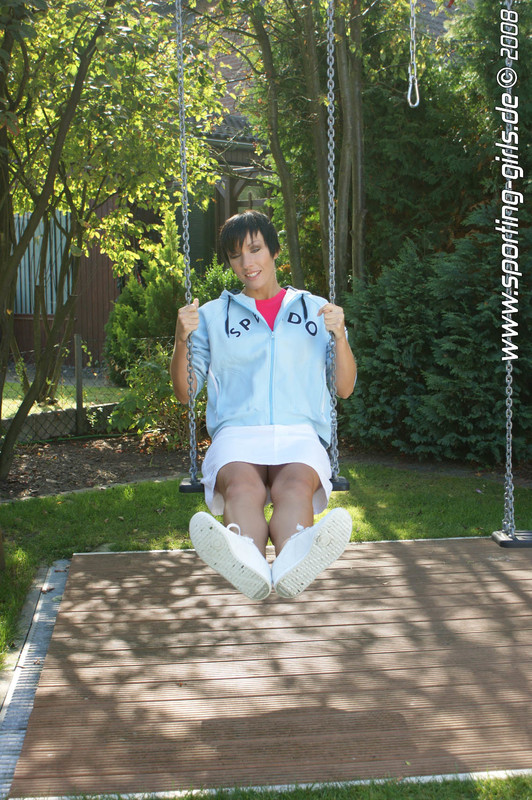 brunette lady Diana in one piece swimsuit