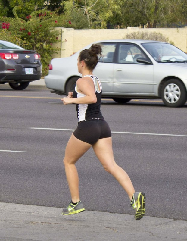 sexy jogger girl running in tight black shorts