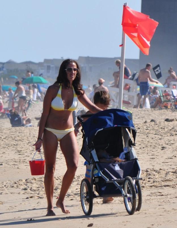 beach milf in kinky bikini