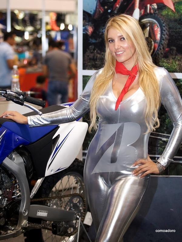 blonde promo girl in shiny silver bodysuit