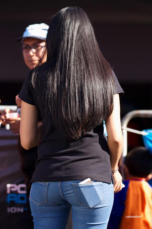 lovely brunette lady in tight blue jeans
