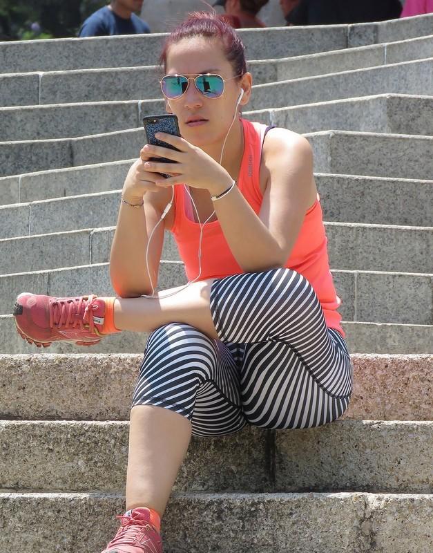beautiful female in capri leggings