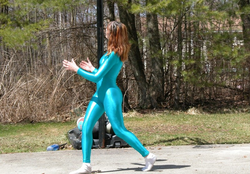 basketball chick Tiffany in shiny cyan catsuit