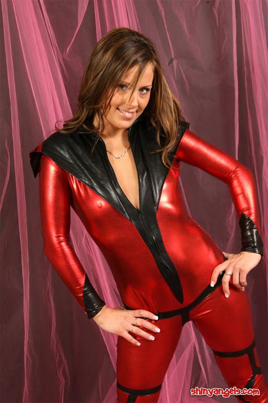 handsome shiny angel in red wetlook catsuit