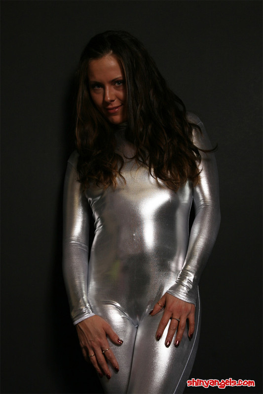 beautiful shiny angel in silver catsuit