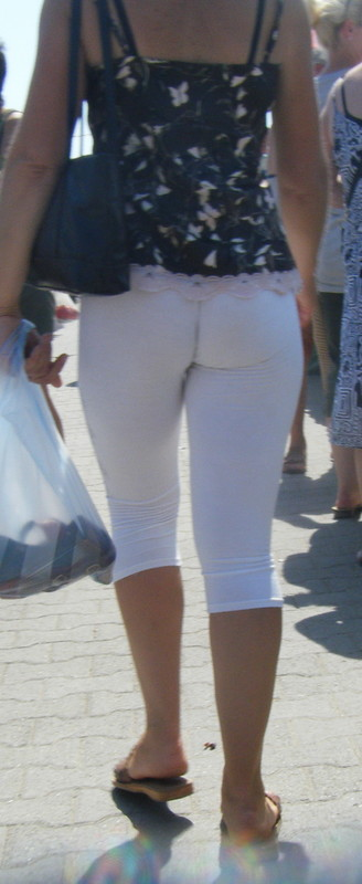 naughty milf in white capri leggings