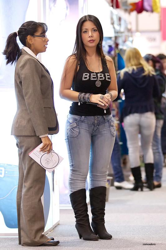 hispanic beauty in tight denim pants & boots