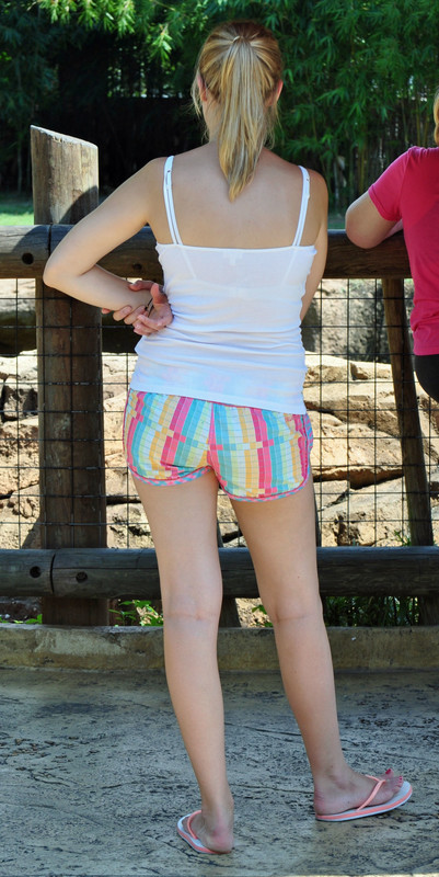blonde chick ass in colorful shorts