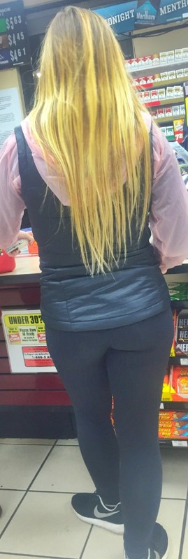 awesome blonde female in black lycra pants