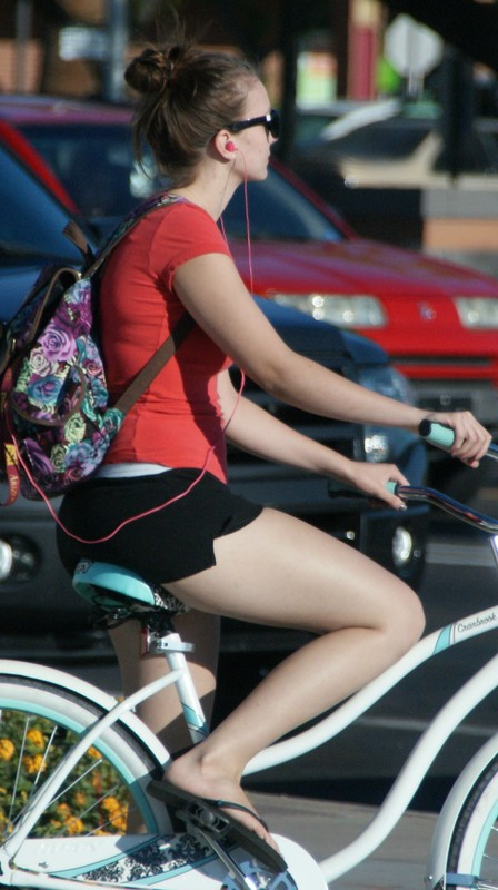 bicycle lady in candid fitness shorts