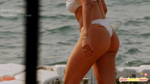 Girls bent over in thong