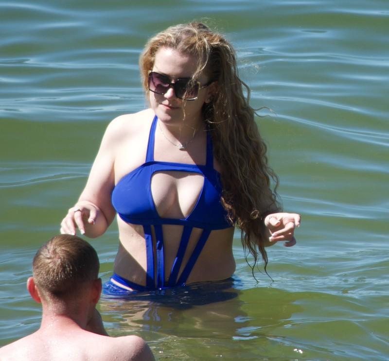 elegant female in blue 1 piece swimsuit