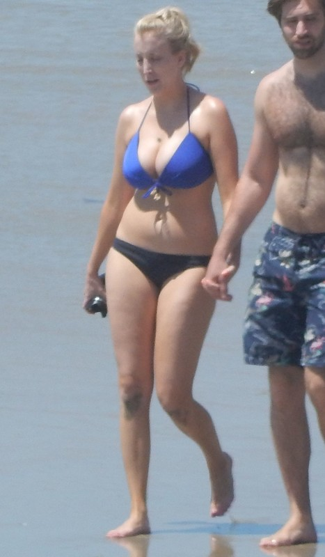 busty blonde lady in sweet bikini