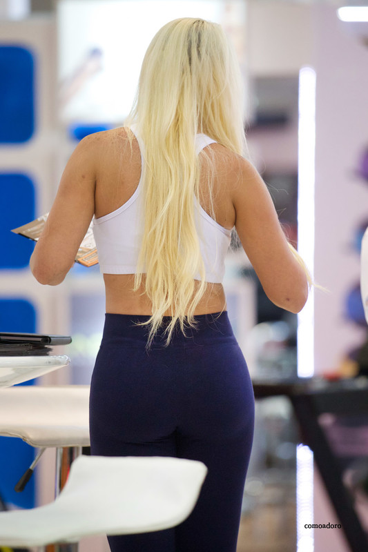 busty blonde lady in blue fitness pants