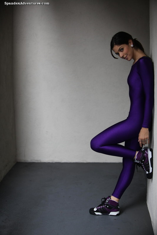 gymnast lady in purple catsuit