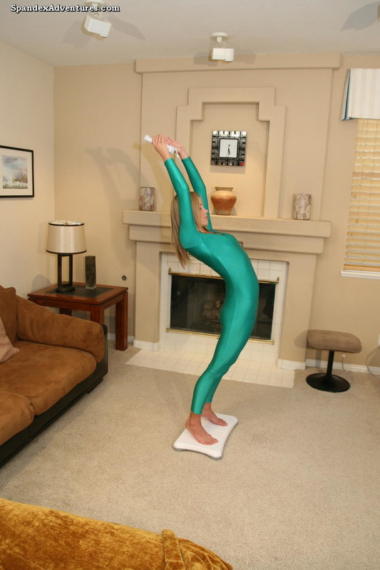 gymnast lady Sarah in sexy green catsuit