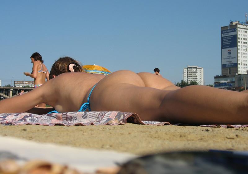 reader girl in sexy blue bikini