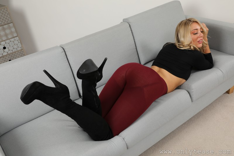 blonde model Daisy A in sexy boots & maroon leggings