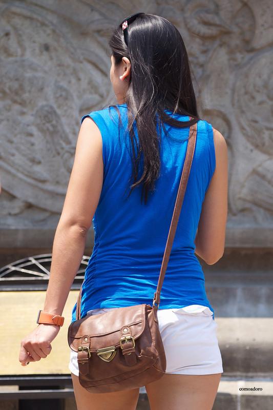 latina female in white shorts