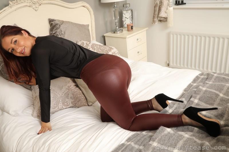 beautiful model Lucie Kent in brown shiny leggings