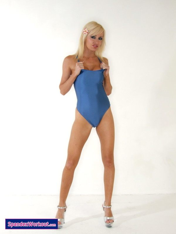 workout lady Charlotte in her shiny blue leotard