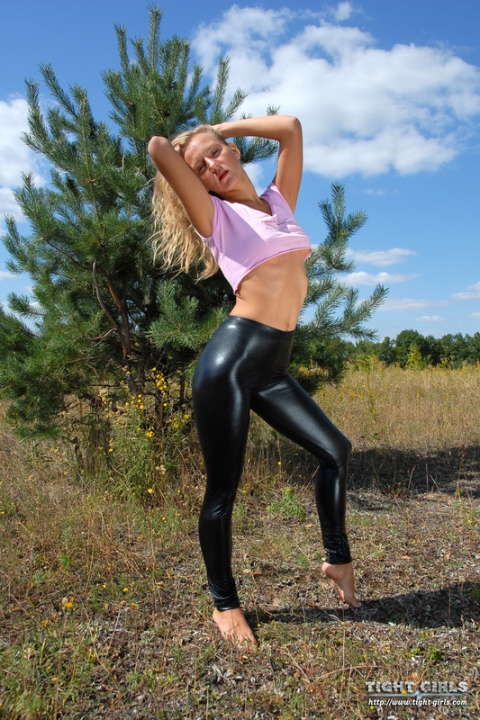handsome coed teen in tight shiny leggings