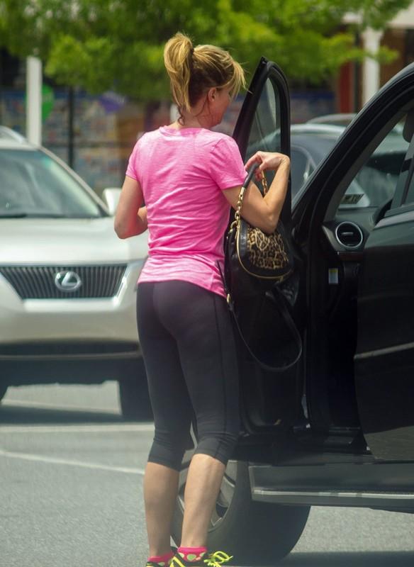 shopping milf booty in skin tight black leggings