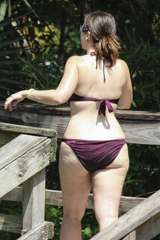 busty milf in maroon bikini