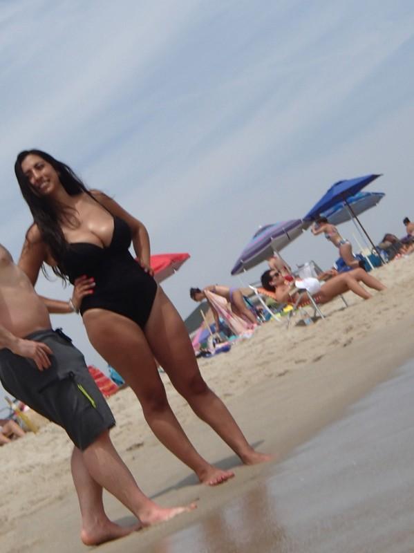 busty beach cleavage in black bathing suit