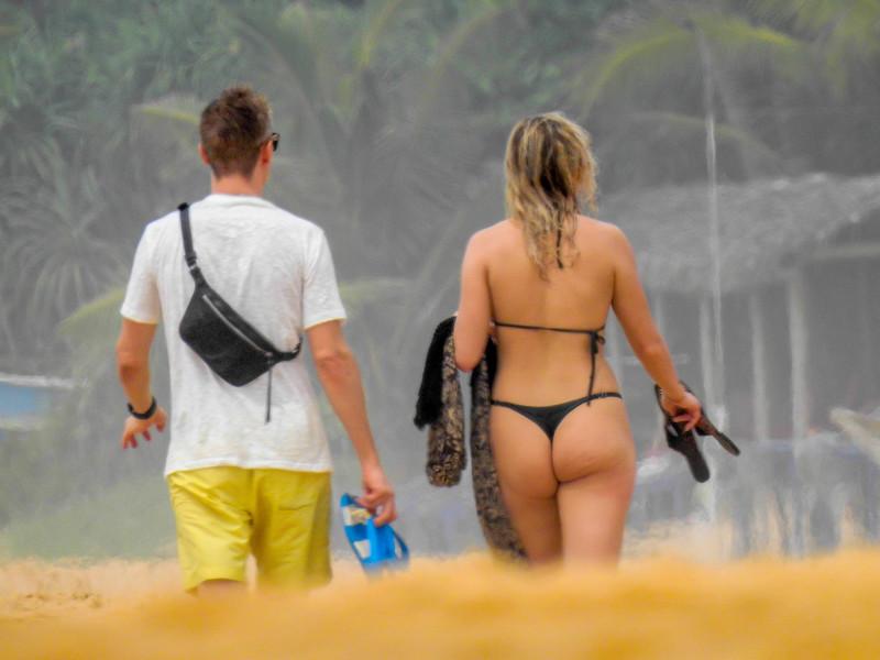 hot blond wife in black string bikini