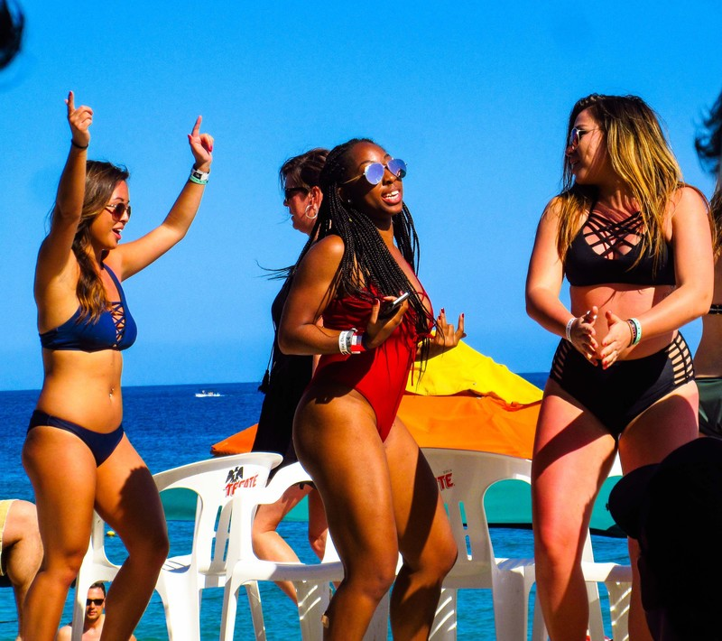 beach party girls dancing in swimsuits