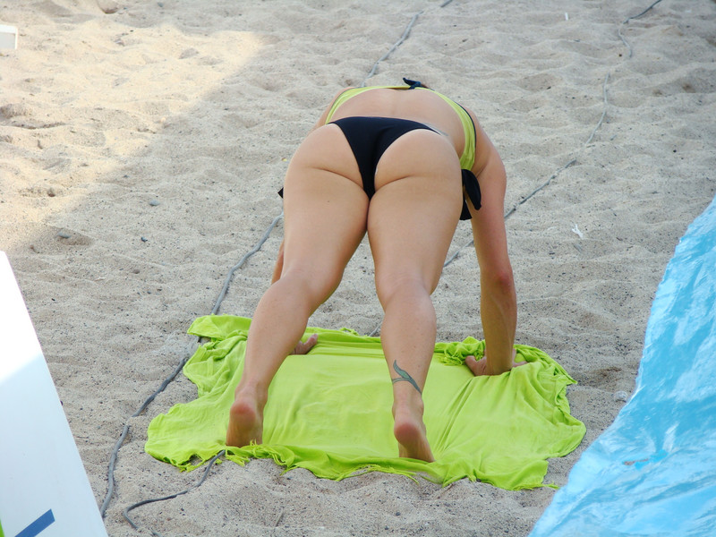 beautiful women playing professional sand volleyball