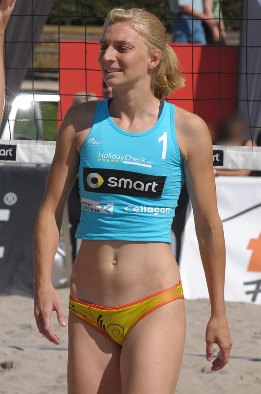 beach volleyball cute blonde in blue and yellow spandex