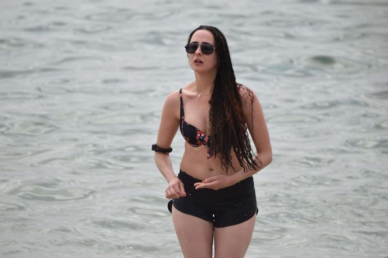 beach jogger lady in sexy bikini top & shorts