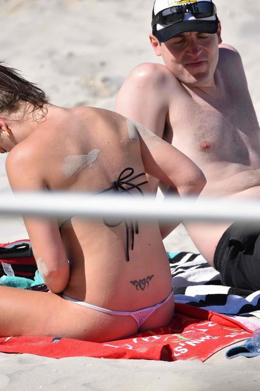 g string lady on the beach