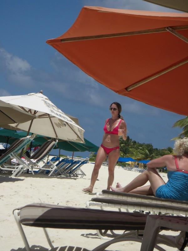 hot milf with nice boobs in red bikini at beach