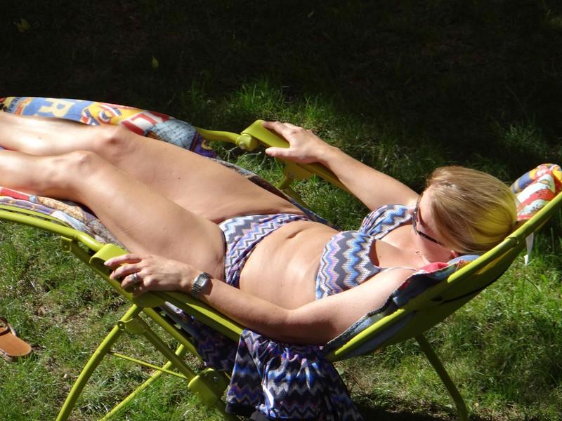 busty milf sunbathing in sexy bikini