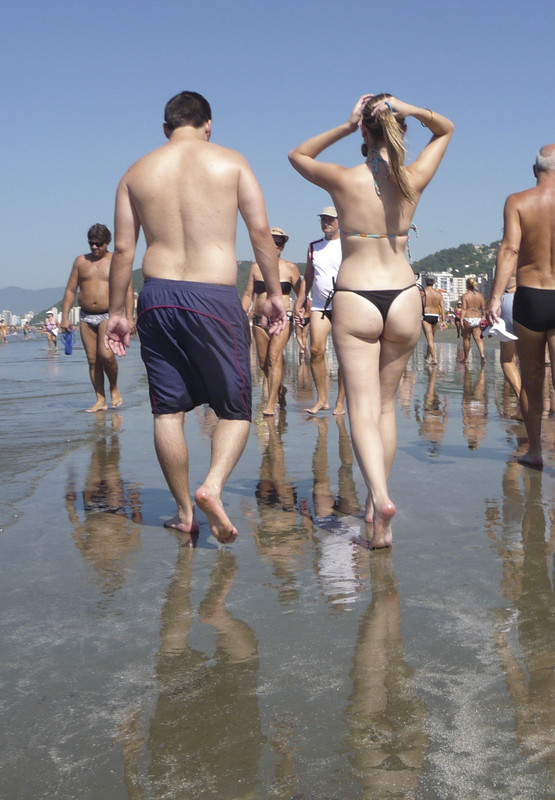 pale skin blonde strolls on the beach and shows her hot ass in thong