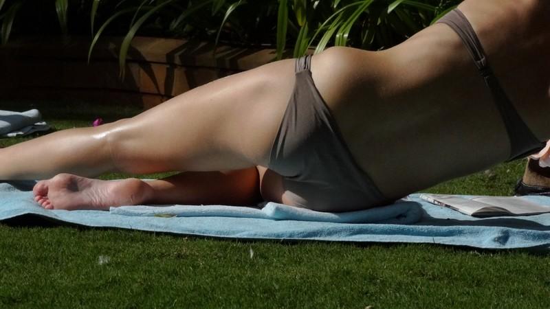 park sunbather lady in candid bikini