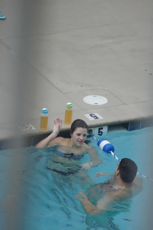 swimming pool female in wet bikini
