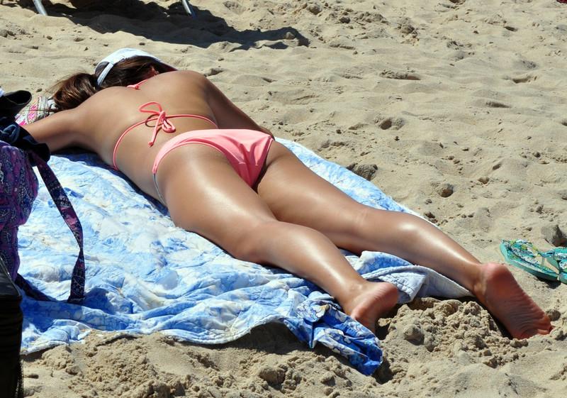 sweet sunbather in peach bikini