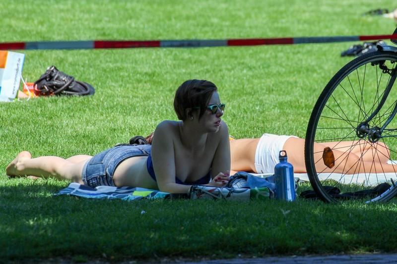 sunbather lady in sexy denim shorts & strapless bikini top