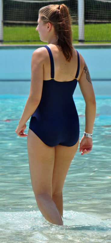 curvy lady in deep blue 1 piece swimsuit