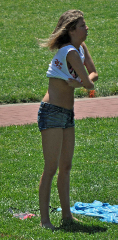 city park lady in sexy denim shorts