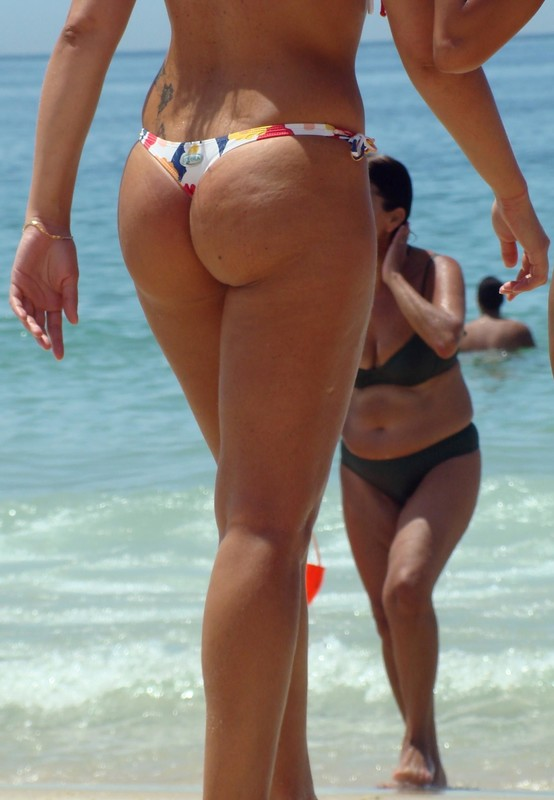 hispanic beach lady in wet bikini
