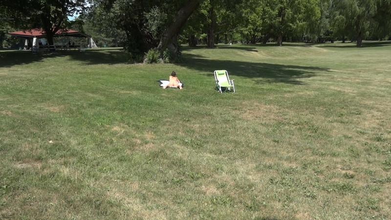 orange bikini lady sunbathing at the park